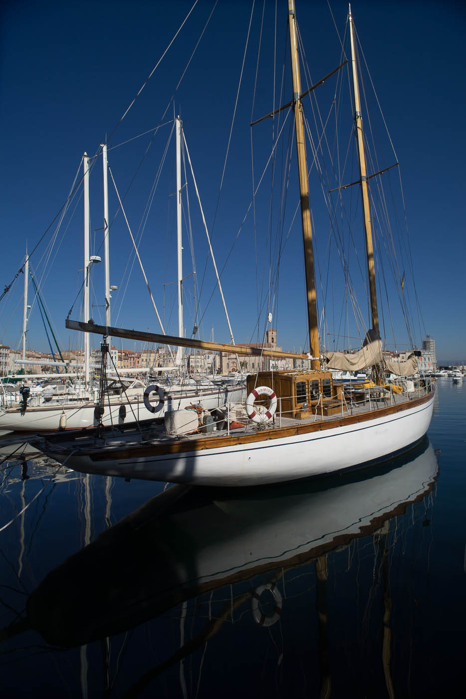 A classic wooden yacht in the old port of La Ciotat