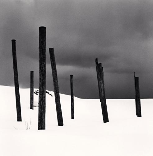Seven posts in snow, Rumoi, Hokkaido, Japan. (c) Michael Kenna, 2004.